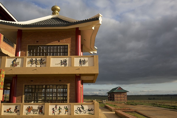 The facade of the Buddhist temple is adorned with paintings in the local Swazi style. The clash of Chinese palatial architecture and local art comes together at the Amitofo Care Centre near Nhlangano, Swaziland. In the distance is the primary school, which was opened by King Mswati III, who gifted the land to the centre. Amitofo houses some 180 orphans and vulnerable children here, where they learn the local school curriculum as well as Buddhism, Mandarin Chinese and Kung Fu. CORNELL TUKIRI © 27 February 2017